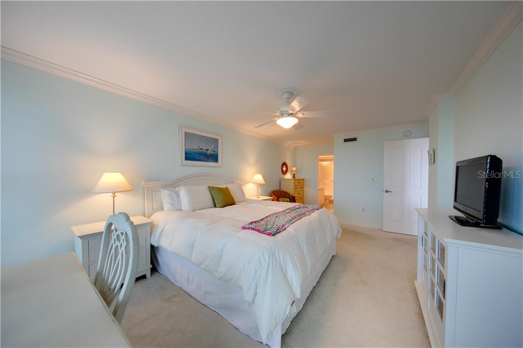 Another view of the master bedroom.  Ensuite bath and walk-in closet are in the background. - Condo for sale at 555 The Esplanade N #102, Venice, FL 34285 - MLS Number is A4450635