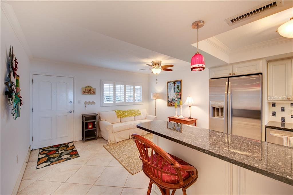 View kitchen and bonus room. - Condo for sale at 555 The Esplanade N #102, Venice, FL 34285 - MLS Number is A4450635