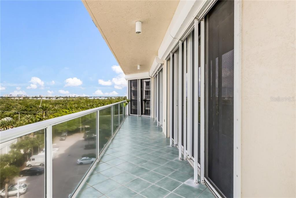 Wrap around terrace with bay and city views.  Kitchen sliders at end of terrace. - Condo for sale at 1800 Benjamin Franklin Dr #b506, Sarasota, FL 34236 - MLS Number is A4451047