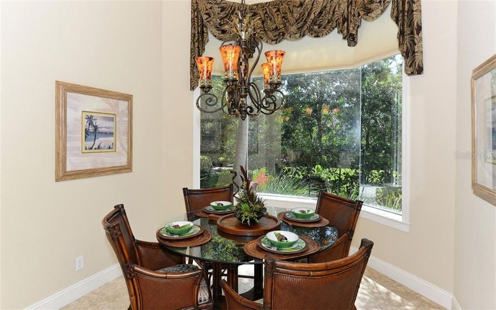 Dinette - Single Family Home for sale at 586 N Macewen Dr, Osprey, FL 34229 - MLS Number is A4451482