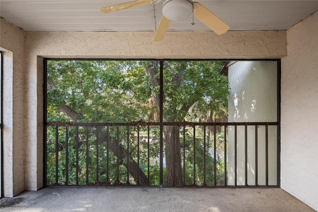 Private Screened Lanai Shaded by Enchanting Canopy Trees, Overlooking Phillippi Creek - Condo for sale at 2731 Orchid Oaks Dr #301, Sarasota, FL 34239 - MLS Number is A4452031