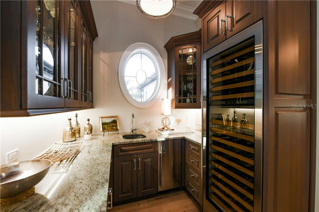 Wet Bar off of Great Room with Subzero Wine Frig. - Single Family Home for sale at 16119 Baycross Dr, Lakewood Ranch, FL 34202 - MLS Number is A4452632