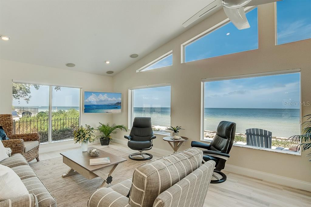Family room overlooking Tampa Bay - Single Family Home for sale at 867 N Shore Dr, Anna Maria, FL 34216 - MLS Number is A4454292