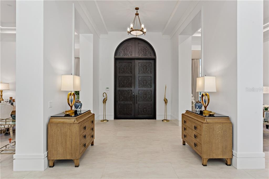 Be welcomed by this elegant entry with 13' cast iron doors, 10