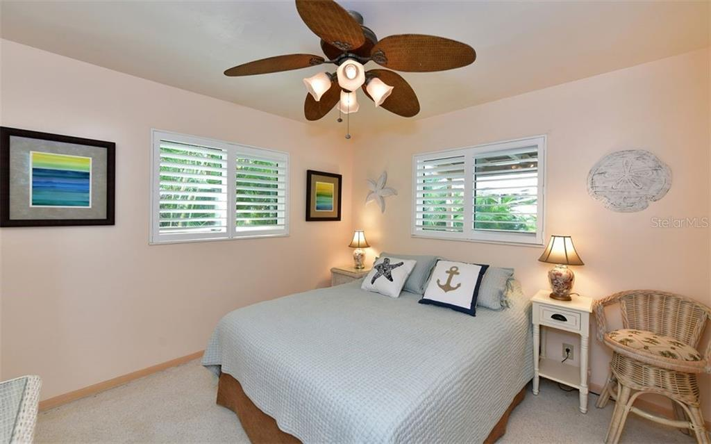 Guest bedroom with en-suite bath downstairs - Single Family Home for sale at 623 Avenida Del Norte, Sarasota, FL 34242 - MLS Number is A4454692