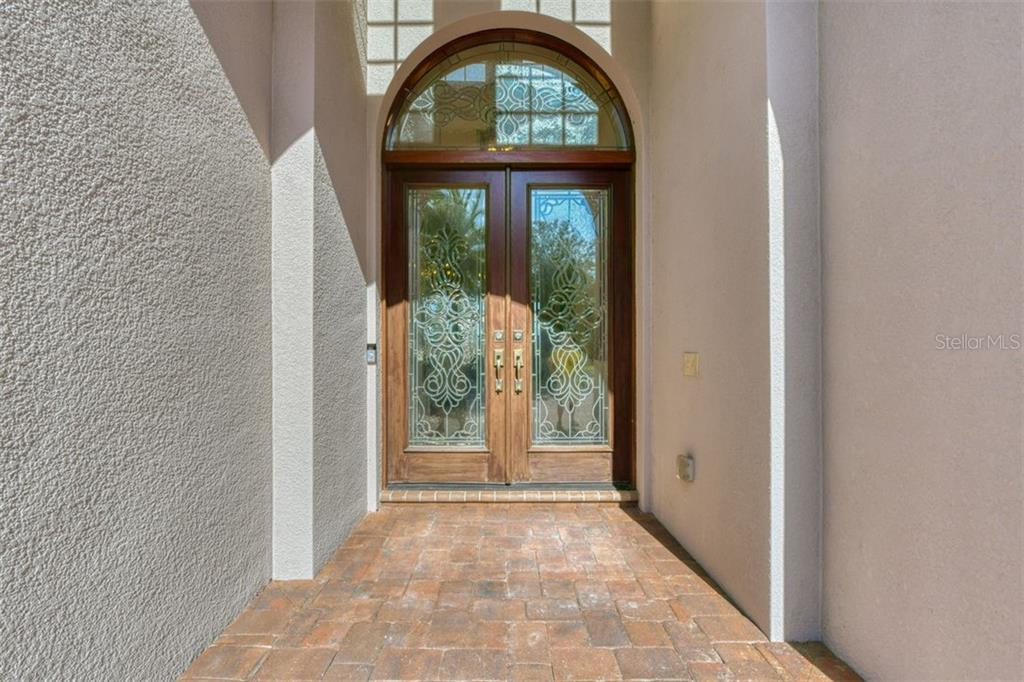 A leaded glass double door entry - Single Family Home for sale at 3719 Founders Club Dr, Sarasota, FL 34240 - MLS Number is A4455099