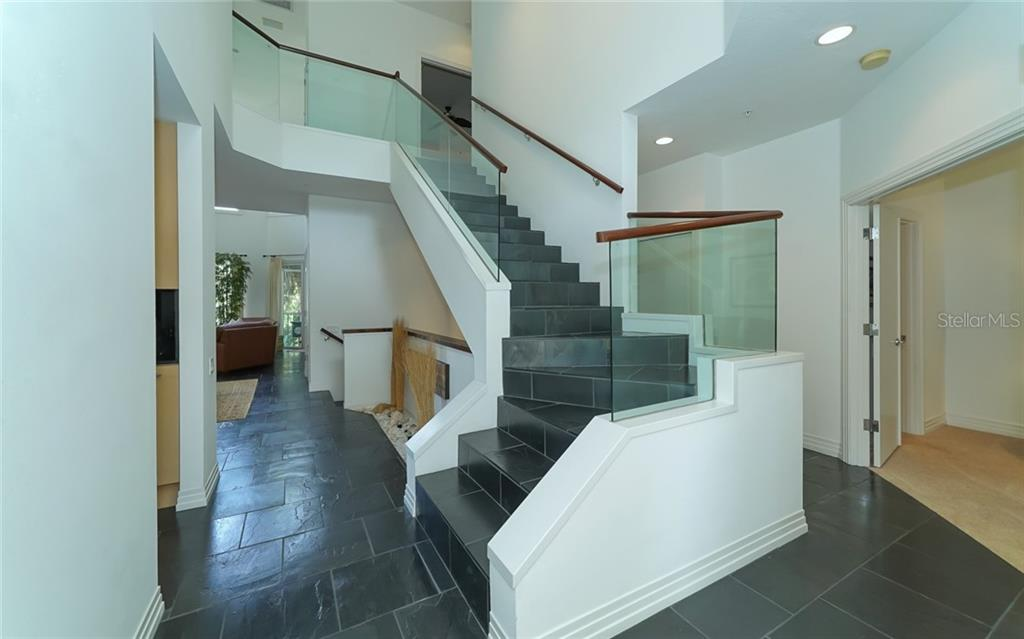 Stunning staircase to upper bedrooms & loft. - Condo for sale at 3994 Hamilton Club Cir #18, Sarasota, FL 34242 - MLS Number is A4455281