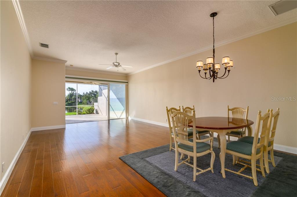 Dining / Living Room - Villa for sale at 4560 Samoset Dr, Sarasota, FL 34241 - MLS Number is A4455487