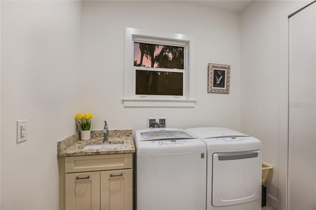 Laundry room with utility sink. - Single Family Home for sale at 6125 1st Ter E, Palmetto, FL 34221 - MLS Number is A4455618