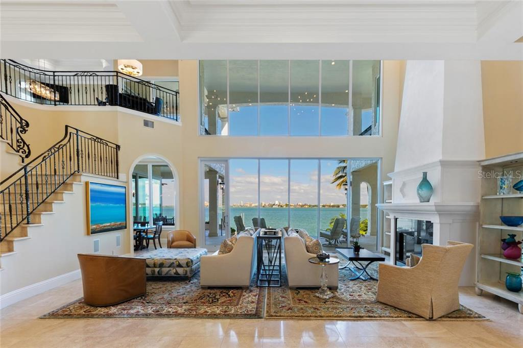 Gas heated infinity pool and spa. New dock with 20,000 lb beamless boat lift and two adjacent 7,000 lb jetski/kayak lifts. Dock equipped with electric, water, snook light and fish cleaning station. - Single Family Home for sale at 901 Norsota Way, Sarasota, FL 34242 - MLS Number is A4456224