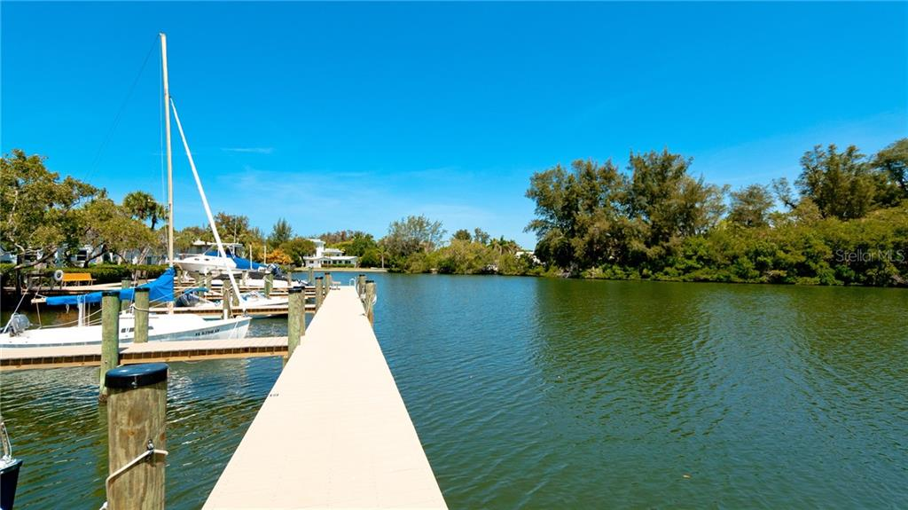 SERENE BISHOP'S BAYOU LEADS TO SARASOTA BY & PROVIDES OWNERS WITH EXCELLENT BOATING, KAYAKING, PADDLE BOARDING & FISHING ACTIVITIES. DOLPHINS & MANATEES ARE DAILY VISITORS HERE. - Condo for sale at 6700 Gulf Of Mexico Dr #116, Longboat Key, FL 34228 - MLS Number is A4456442