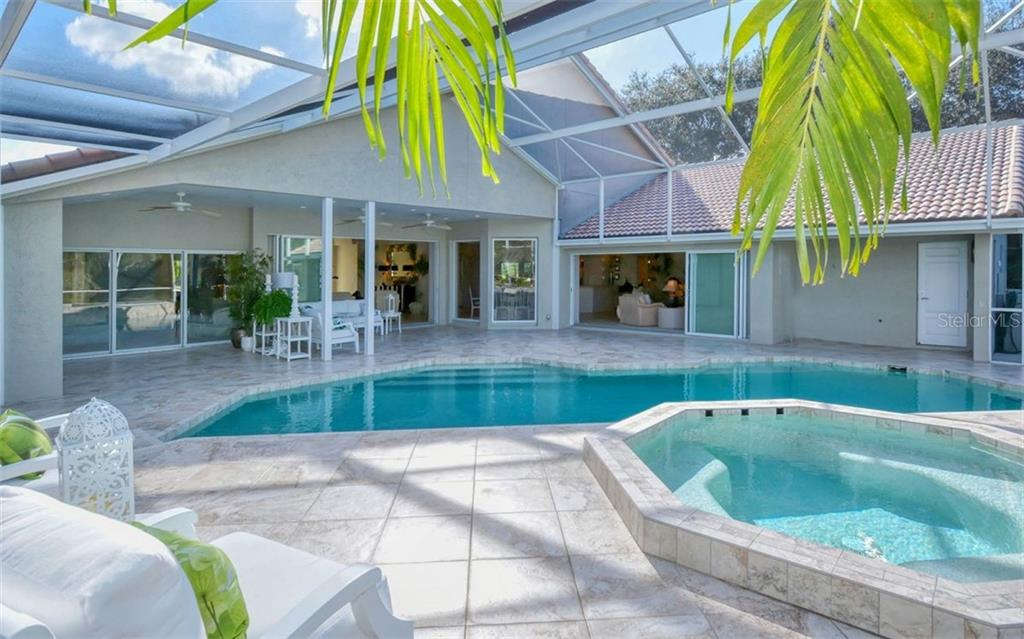Salt water heated with propane. Overlooks water view. - Single Family Home for sale at 4177 Escondito Cir, Sarasota, FL 34238 - MLS Number is A4456531