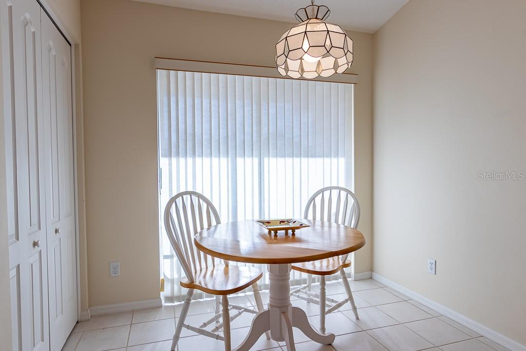 Dinette in kitchen w/sliding glass doors to lanai - Condo for sale at 9570 High Gate Dr #1722, Sarasota, FL 34238 - MLS Number is A4457005