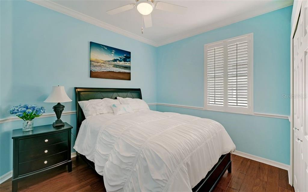 Bedroom 2 - Single Family Home for sale at 6510 Field Sparrow Gln, Lakewood Ranch, FL 34202 - MLS Number is A4457243
