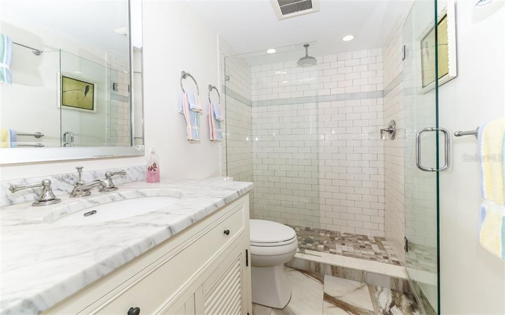 Guest Bathroom - Condo for sale at 5635 Gulf Of Mexico Dr #102, Longboat Key, FL 34228 - MLS Number is A4458745