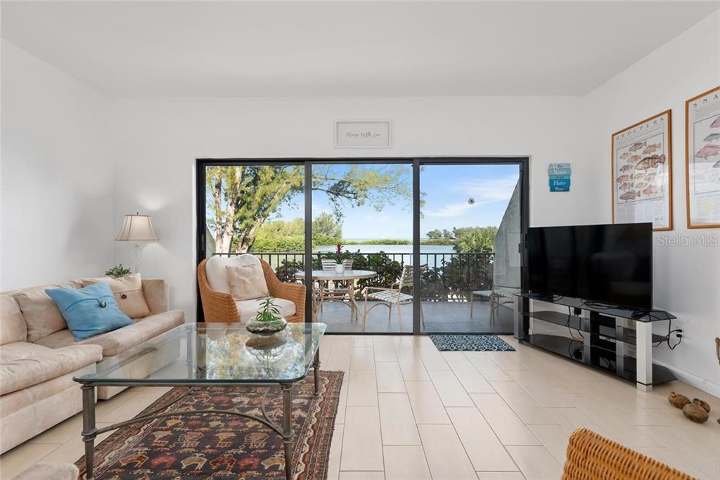 From the moment you walk in there is that view! - Condo for sale at 490 N Shore Rd #7, Longboat Key, FL 34228 - MLS Number is A4461297