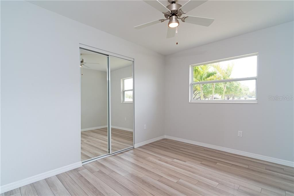 Front Bedroom #1 - Single Family Home for sale at 5057 Bell Meade Dr, Sarasota, FL 34232 - MLS Number is A4461883