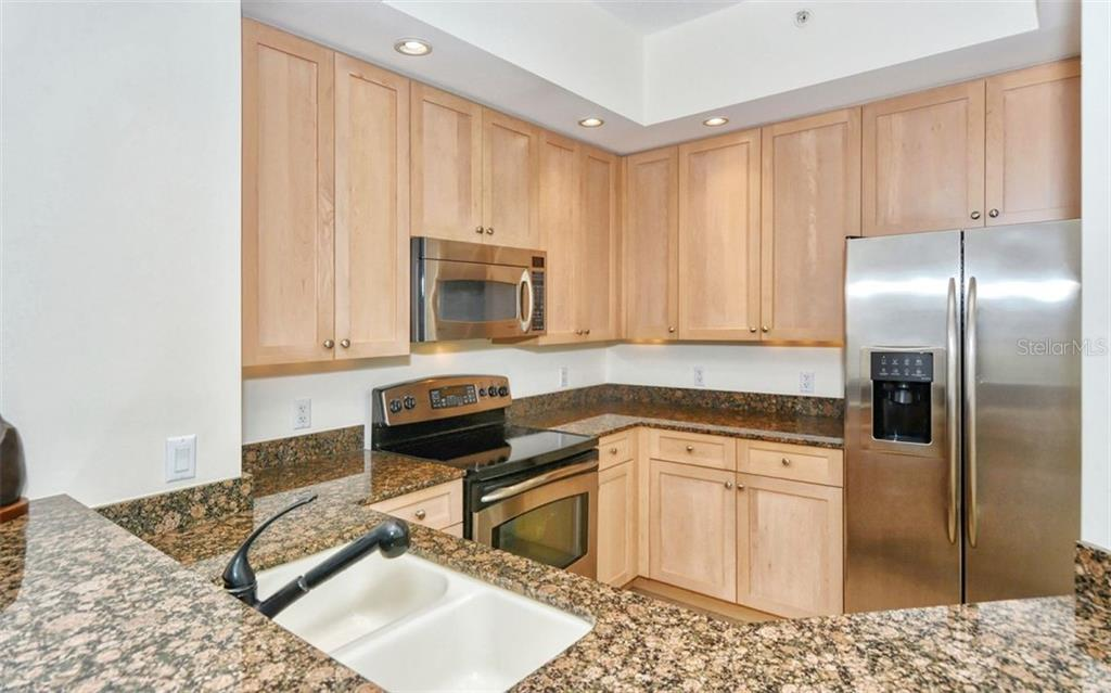 Kitchen with plenty of counter space and storage - Condo for sale at 100 Central Ave #A401, Sarasota, FL 34236 - MLS Number is A4463296