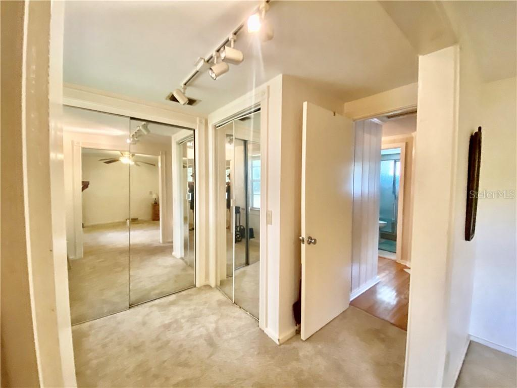 Changing room, view of both closets.  To the right is the entry to the hall. - Single Family Home for sale at 4300 Eastern Pkwy, Sarasota, FL 34233 - MLS Number is A4464200