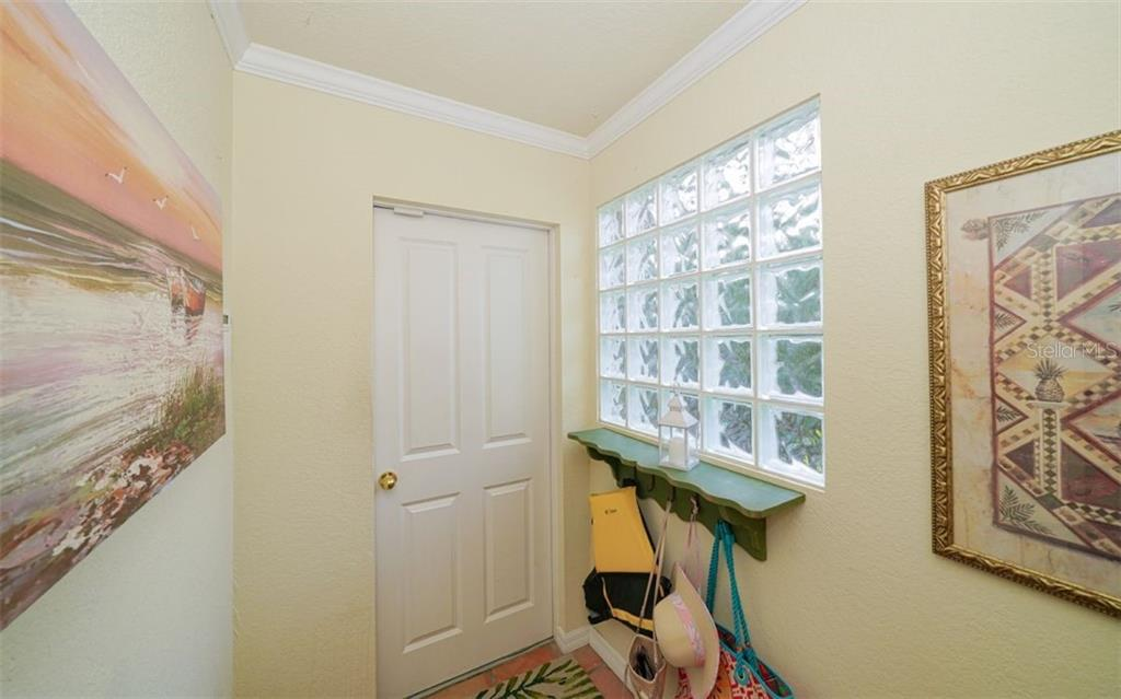 GARAGE ENTRY HALLWAY - Single Family Home for sale at 3 Winslow Pl, Longboat Key, FL 34228 - MLS Number is A4464990