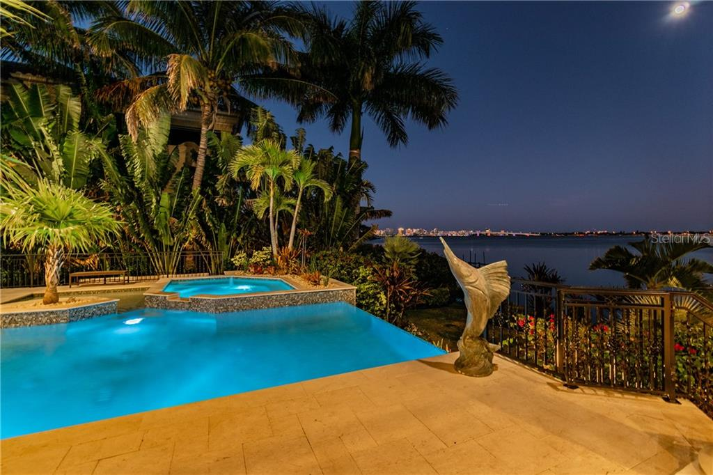Night pool view with backdrop of downtown lights/Ringling bridge - Single Family Home for sale at 1418 John Ringling Pkwy, Sarasota, FL 34236 - MLS Number is A4467093