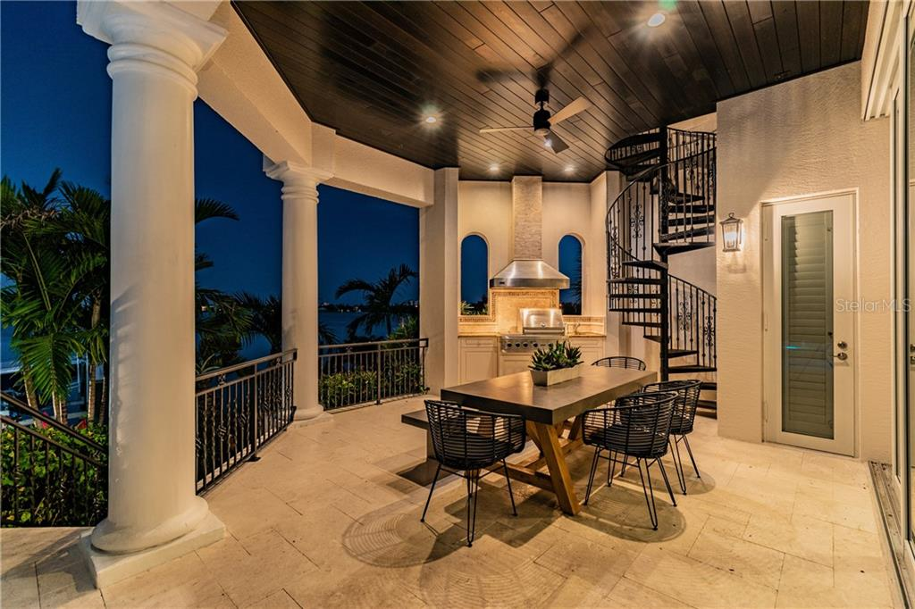 Main Level Al Fresco Dining night view - Single Family Home for sale at 1418 John Ringling Pkwy, Sarasota, FL 34236 - MLS Number is A4467093