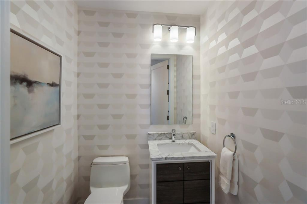 The powder bath exudes sophistication while staying playful. - Condo for sale at 1155 N Gulfstream Ave #1404, Sarasota, FL 34236 - MLS Number is A4467921