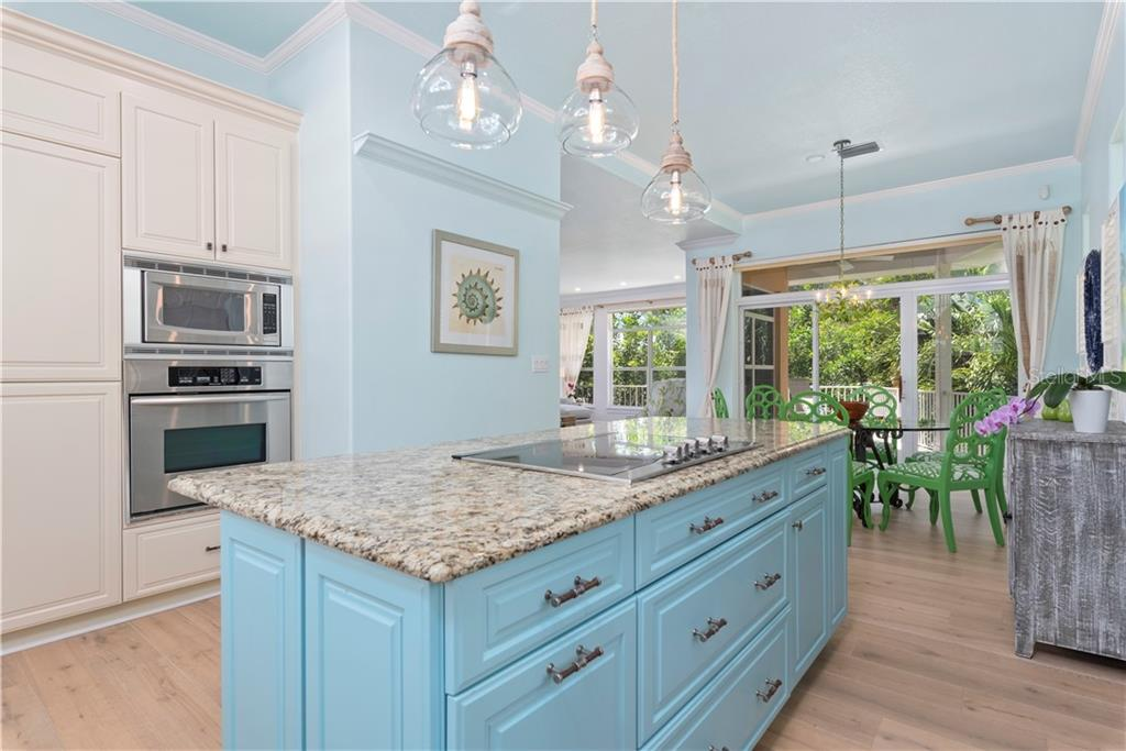 Open concept kitchen with granite counters, stainless appliances - Single Family Home for sale at 97 52nd St, Holmes Beach, FL 34217 - MLS Number is A4468151