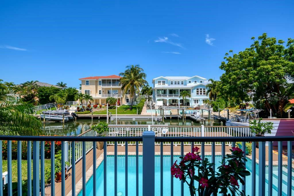 Outdoor terrace overlooking the saltwater pool - Single Family Home for sale at 605 N Point Dr, Holmes Beach, FL 34217 - MLS Number is A4469001