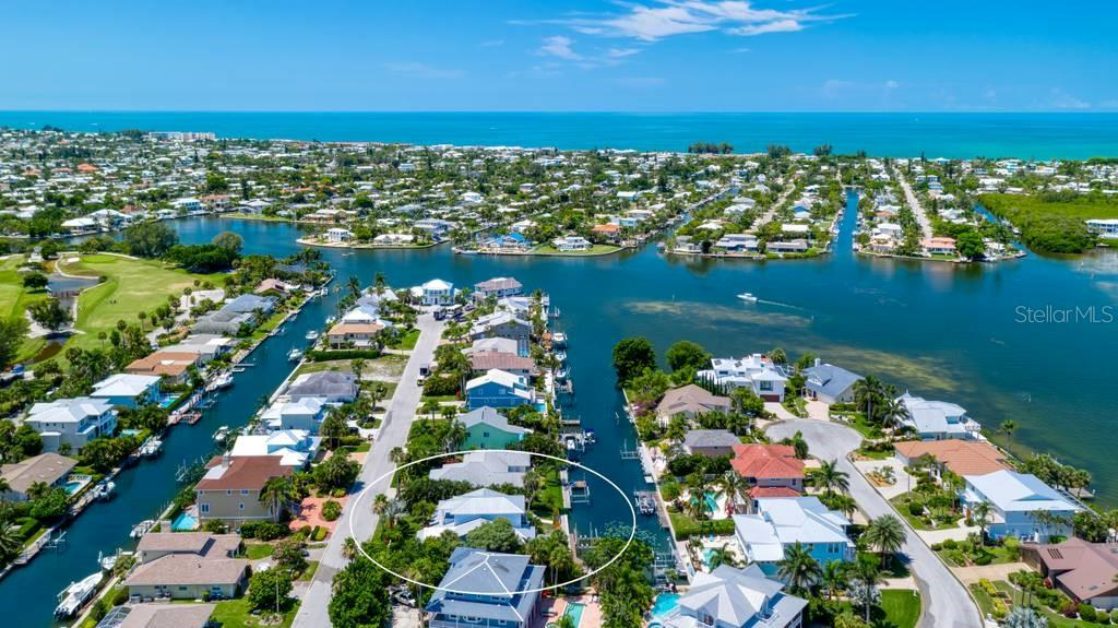 Aerial view of home and Bimini Bay - Single Family Home for sale at 605 N Point Dr, Holmes Beach, FL 34217 - MLS Number is A4469001