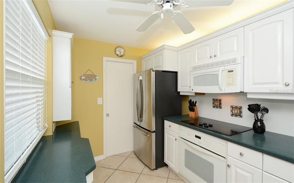 Kitchen has walk-in pantry. - Condo for sale at 1770 Benjamin Franklin Dr #706, Sarasota, FL 34236 - MLS Number is A4469463