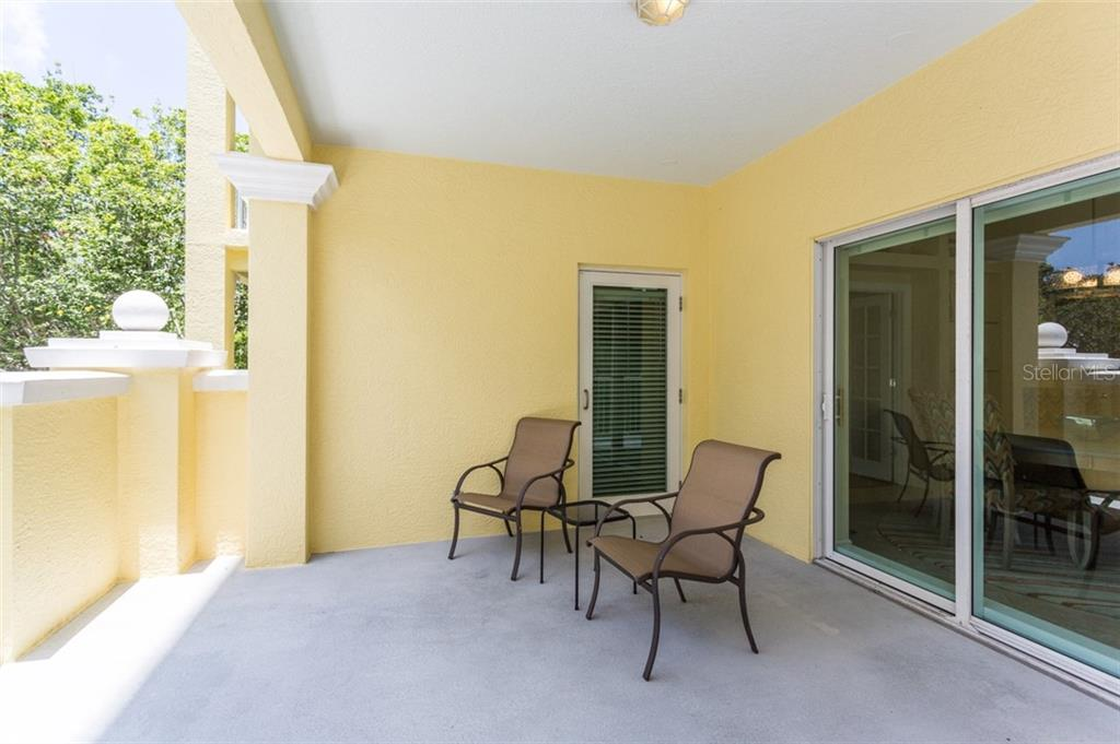 Balcony off dining area - Condo for sale at 1308 Old Stickney Point Rd #W24, Sarasota, FL 34242 - MLS Number is A4471155