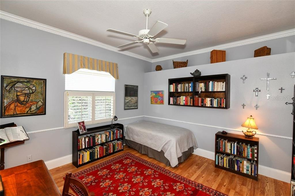 Den/Study/third bedroom.  Pocket doors and plantation shutters. - Villa for sale at 4590 Samoset Dr, Sarasota, FL 34241 - MLS Number is A4471881