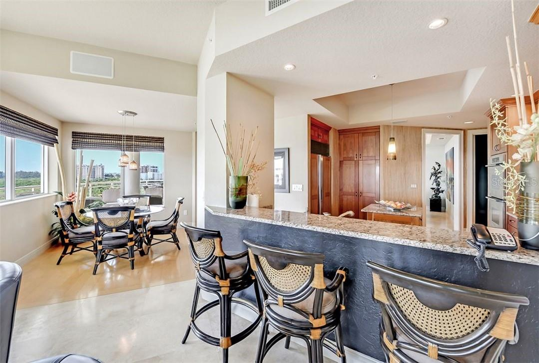 Custom built kitchen w/ stainless steel appliances and granite countertops - Condo for sale at 1300 Benjamin Franklin Dr #708, Sarasota, FL 34236 - MLS Number is A4471978