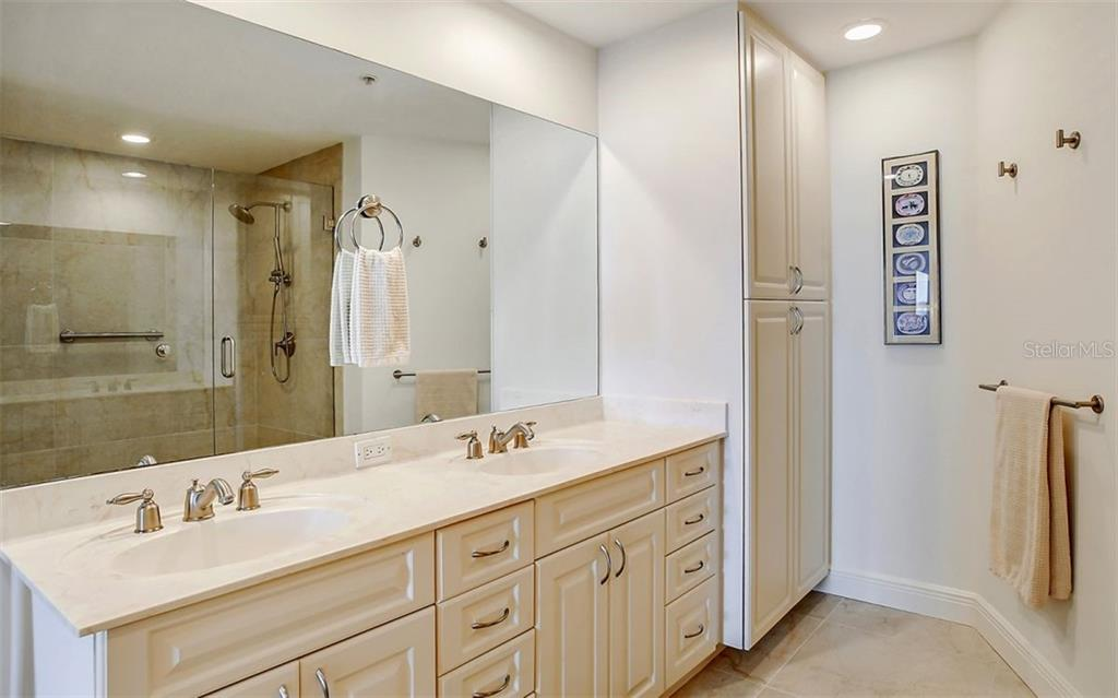 Dual sinks and storage in the master bath - Condo for sale at 1771 Ringling Blvd #1110, Sarasota, FL 34236 - MLS Number is A4474683