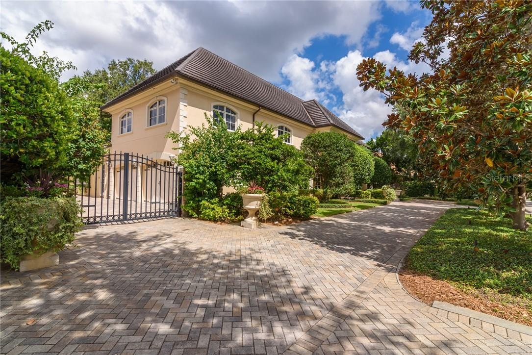 Enter the property via the interlocking brick pavered driveway and the brick motor court of the home which is entirely walled and gated. - Single Family Home for sale at 1807 Oleander St, Sarasota, FL 34239 - MLS Number is A4475067