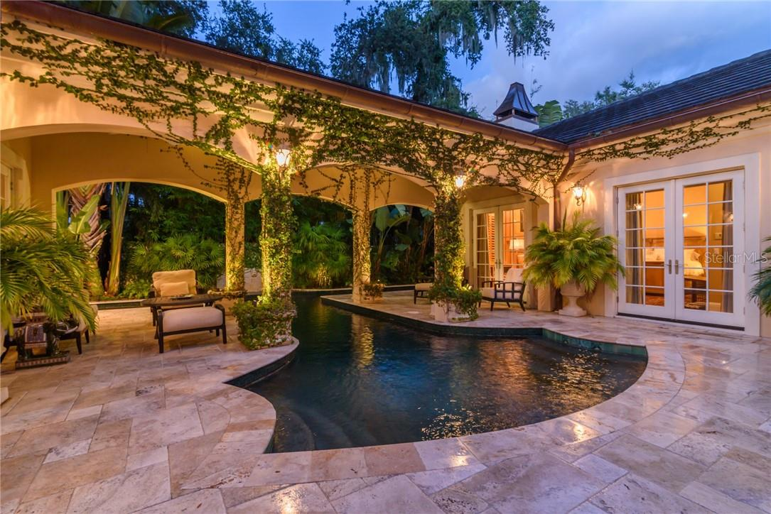 A dreamy Mediterranean pool scape welcomes your swimming in the 45 foot lap pool with custom glass tiles and fountain. - Single Family Home for sale at 1807 Oleander St, Sarasota, FL 34239 - MLS Number is A4475067