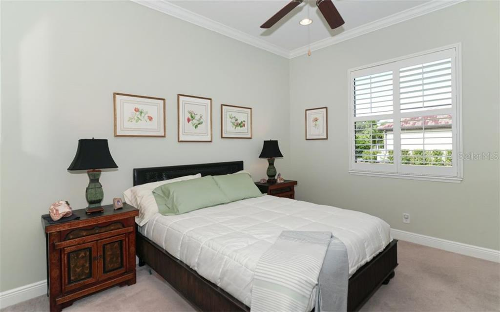 Bedroom 2 on the first floor. - Single Family Home for sale at 3538 Trebor Ln, Sarasota, FL 34235 - MLS Number is A4475545