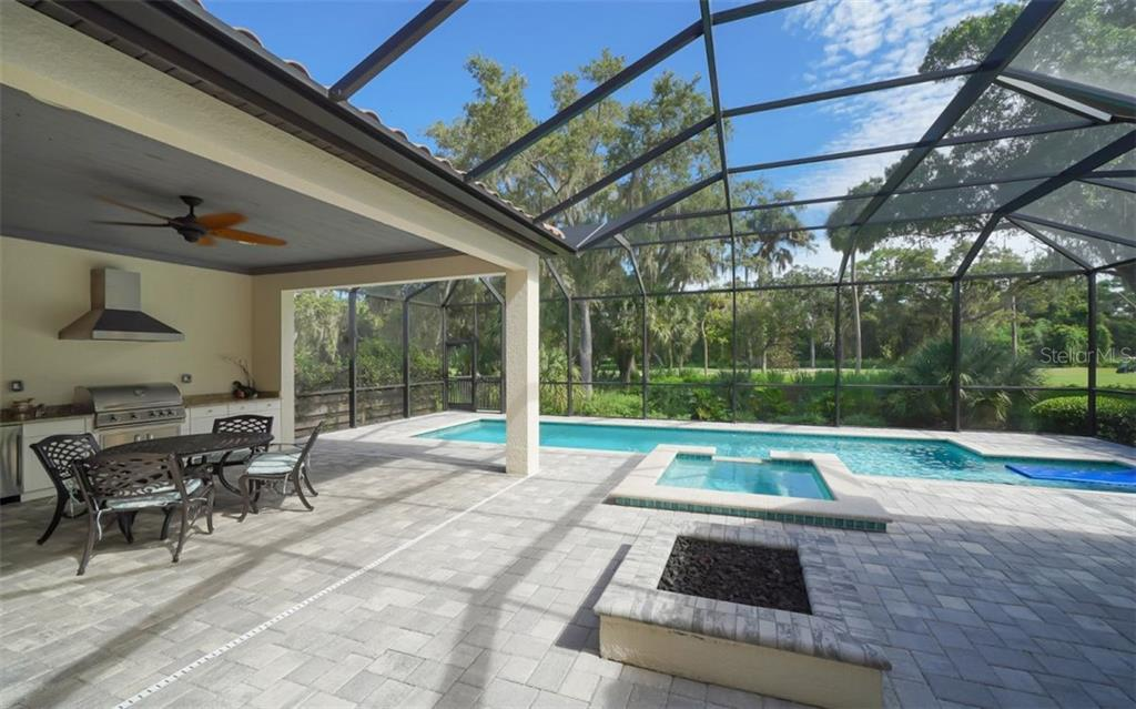 Outdoor kitchen and fire pit - Single Family Home for sale at 3538 Trebor Ln, Sarasota, FL 34235 - MLS Number is A4475545
