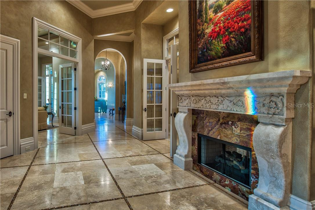 Marble Flooring with Mosaic Tile Inlays and Grande French Doors - Single Family Home for sale at 8499 Lindrick Ln, Bradenton, FL 34202 - MLS Number is A4475594