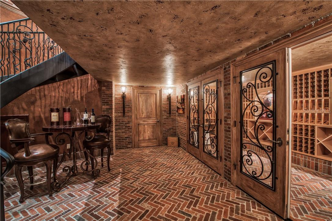 Wine Cellar with Authentic Brick and Pine Wood - Single Family Home for sale at 8499 Lindrick Ln, Bradenton, FL 34202 - MLS Number is A4475594