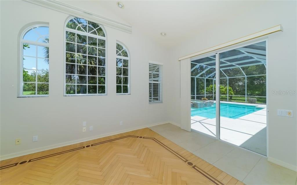 Family room with sliders to pool - Single Family Home for sale at 462 E Macewen Dr, Osprey, FL 34229 - MLS Number is A4476181