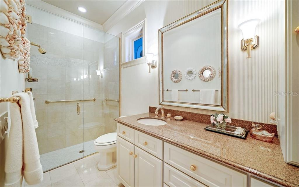 Guest bedroom bathroom - Single Family Home for sale at 35 Lighthouse Point Dr, Longboat Key, FL 34228 - MLS Number is A4477572