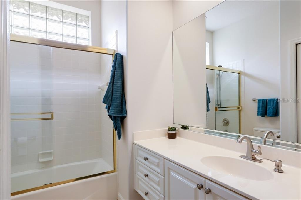 This bath serves as the guest bath for the bedroom and for short term visitors as it is immediately off the entry. - Single Family Home for sale at 9618 53rd Dr E, Bradenton, FL 34211 - MLS Number is A4477826