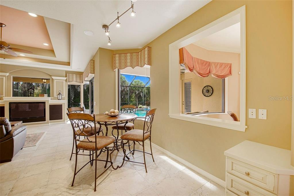 Dinette with stellar views to pool and beyond - Single Family Home for sale at 684 Crane Prairie Way, Osprey, FL 34229 - MLS Number is A4478575
