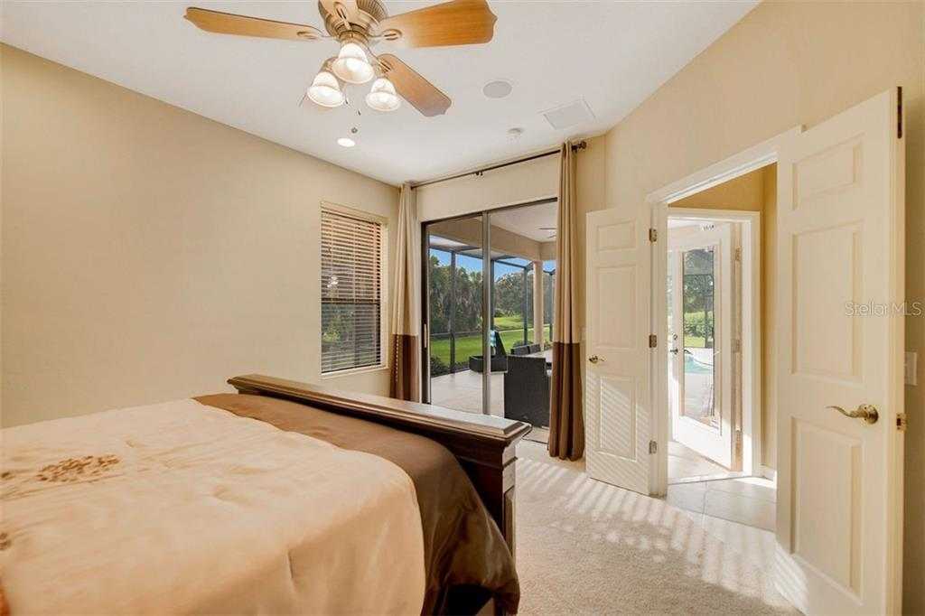 Bedroom 2 pool access and view - Single Family Home for sale at 684 Crane Prairie Way, Osprey, FL 34229 - MLS Number is A4478575