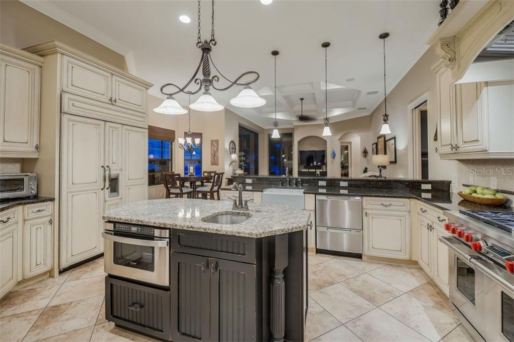 Large kitchen with custom solid wood cabinetry, Subzero refrigerator/freezer, Wolf stove, and Paykel dishwasher - Single Family Home for sale at 14507 Leopard Crk, Lakewood Ranch, FL 34202 - MLS Number is A4478709