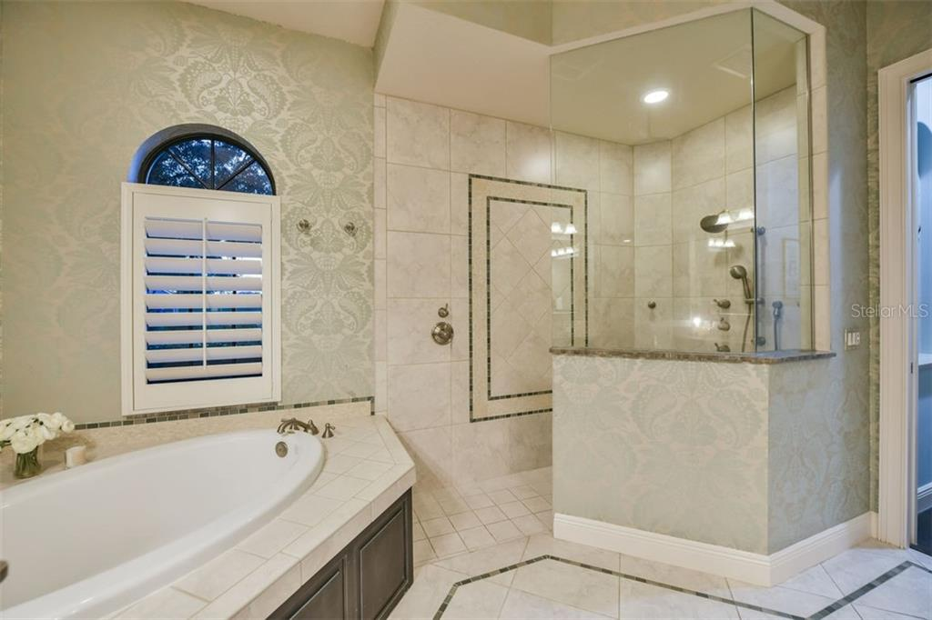 Master bath with glass framed shower - Single Family Home for sale at 14507 Leopard Crk, Lakewood Ranch, FL 34202 - MLS Number is A4478709