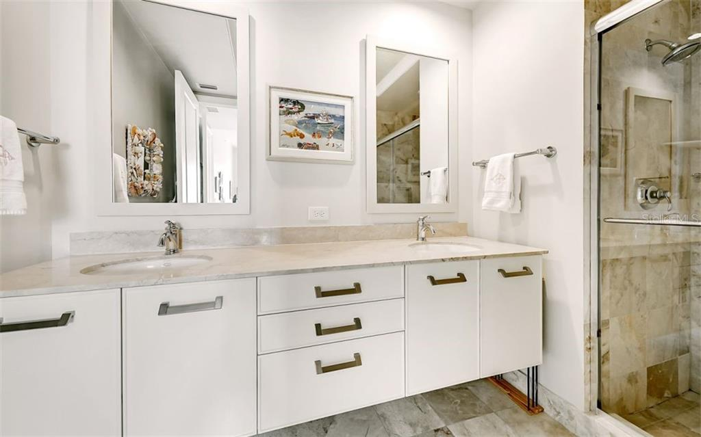 Suite # 2's ensuite bathroom with a dual sinks and a walk-in shower - Condo for sale at 1350 Main St #1601, Sarasota, FL 34236 - MLS Number is A4478753