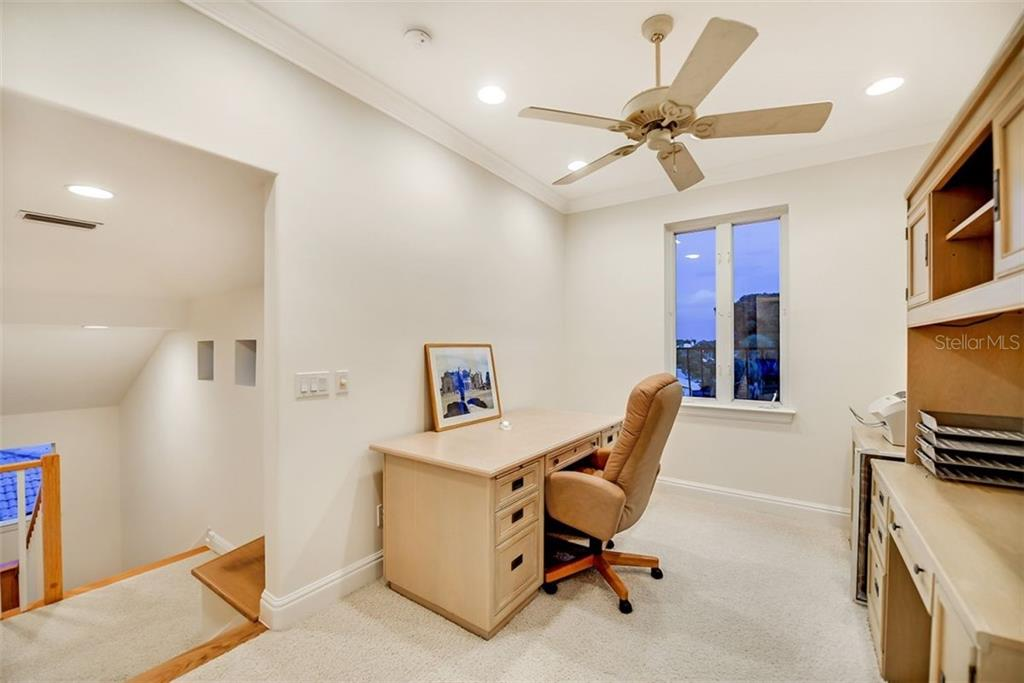 The upper level office / Library with amazing views & great light for reading - Single Family Home for sale at 501 Cutter Ln, Longboat Key, FL 34228 - MLS Number is A4480484